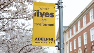 "Adelphi University banner that reads ""where lives are transformed"""