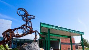 Farmingdale State College Campus with Ram sculpture.
