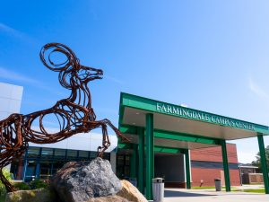 Farmingdale State College Campus with Ram sculpture.