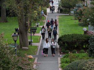 People walking on Adelphi's campus.