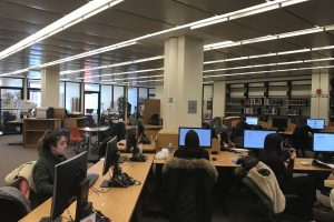 Students working on computers in the Sager Research Area in Swirbul Library