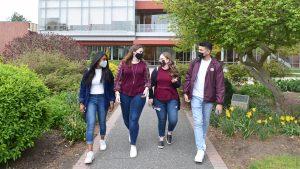 Adelphi students wearing masks on campus.