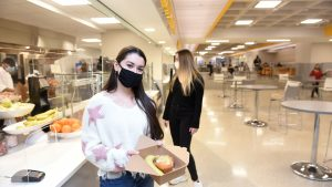 Adelphi students getting food in the newly renovated University Center while wearing masks during the COVID-19 pandemic.