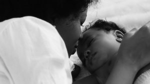 Mother and infant in black and white