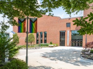 The new UC at Adelphi with pride flags in view.